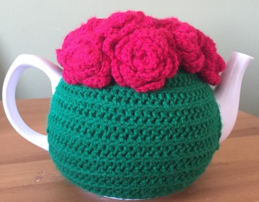 Crochet rose tea cosy