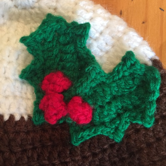 Crochet baby hat Christmas pudding holly leaves