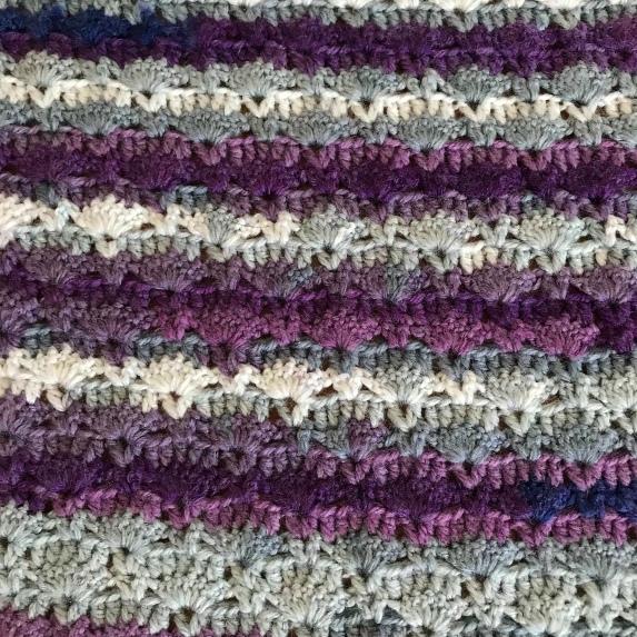 Close up of sunrise shawl using hayfield spirit yarn