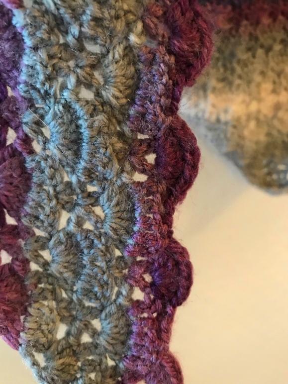 close up of crochet shawl