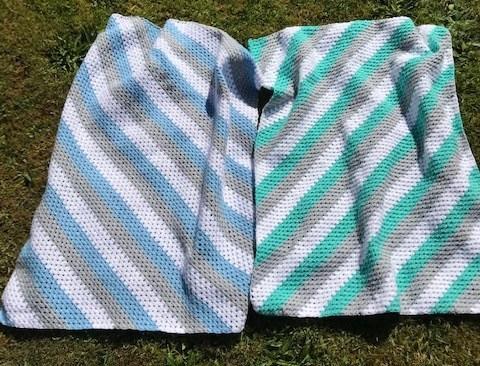 Grey, blue, white and grey granny stitch crochet blanket.