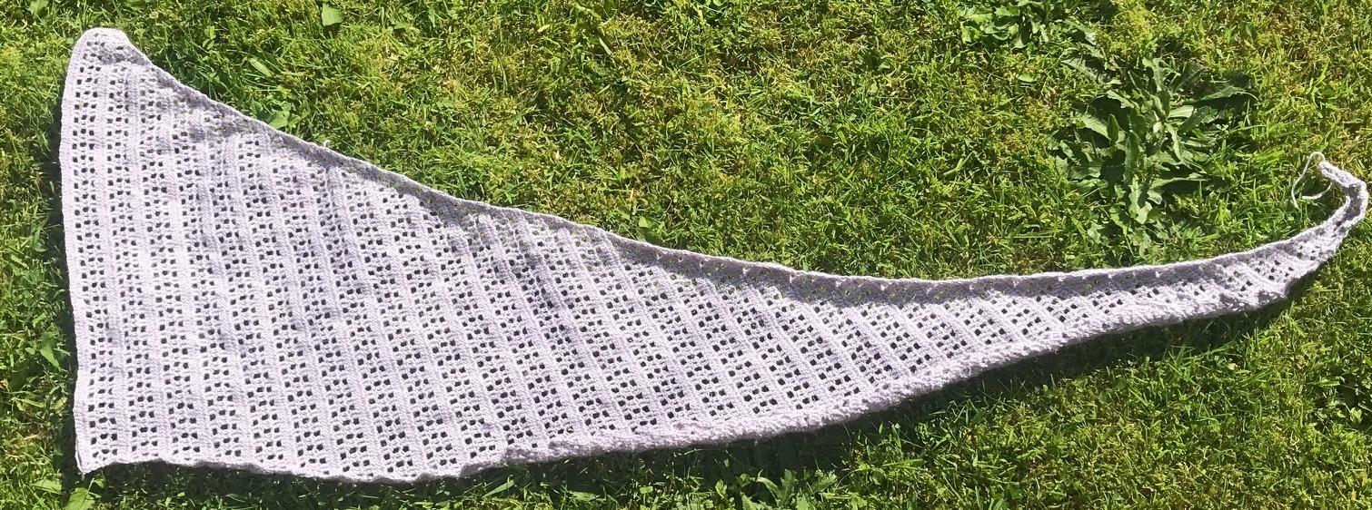 Crochet shawl before blocking