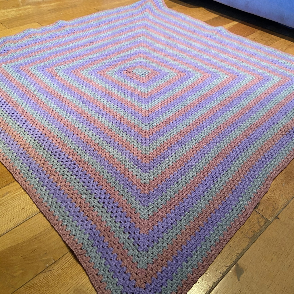 Pink purple and grey granny square blanket