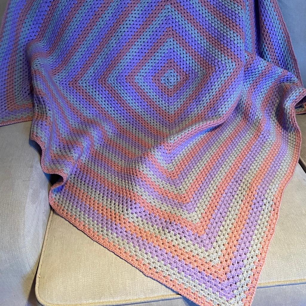 Granny square blanket on sofa