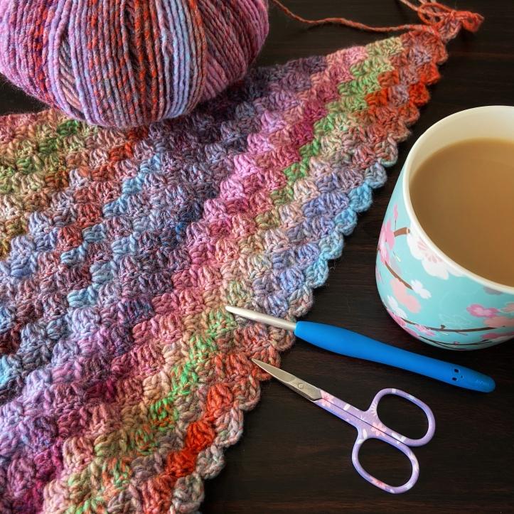 corner to corner crochet blanket sitting on a table
